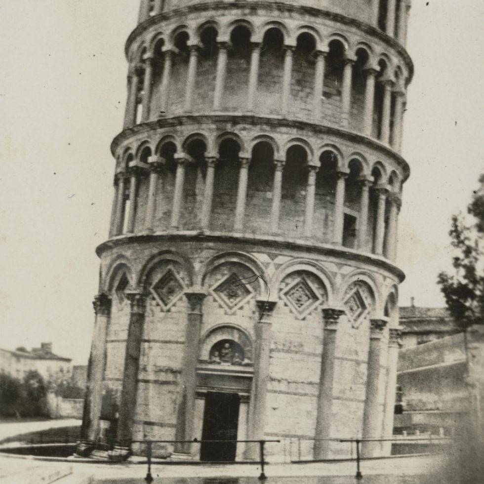 Image: The famous cylindrical tower, leaning to the right with puddles forming on the ground in front.