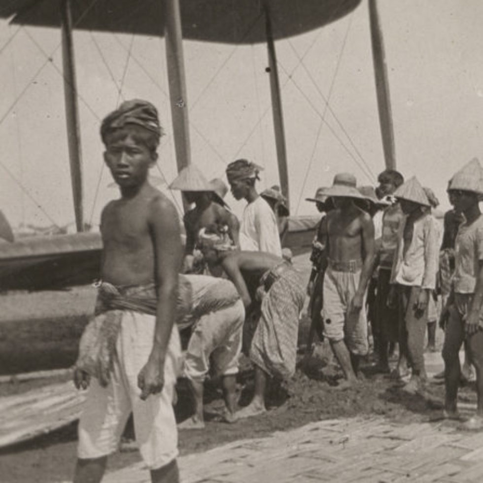Image: Javan locals assisting with a bogged biplane